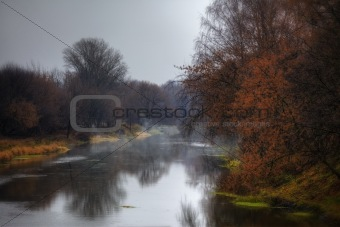 Froggy landscape with autumn river