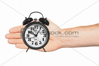 alarm clock in hand isolated on white background
