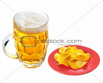 Potato chips on plate and mug of beer isolated on white