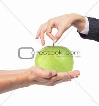 Apple between man and woman hand on white background