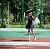young woman play tennis game outdoor