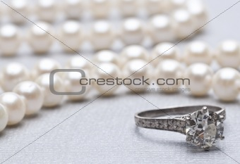 Antique Wedding Ring and Pearls with Focus on Ring.