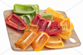 Sliced Green, Red and Orange Bell Peppers
