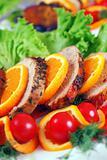 fresh juicy steak sliced, with orange peel and vegetable