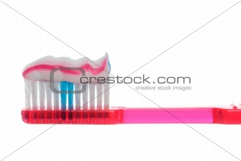 Toothbrush with striped toothpaste