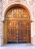 ornate entrance with old wooden door
