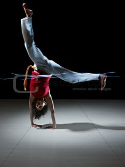 hispanic woman doing capoeira martial art