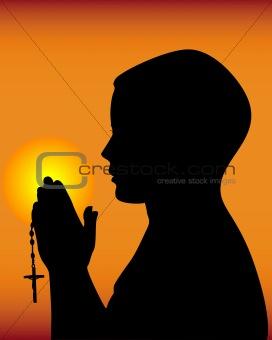 black silhouette of a praying