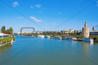 A view of the Guadalquivir River and the Torre del Oro, in Seville, Spain
