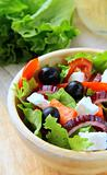Greek  salad with feta cheese, olives and peppers