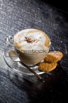 Cappuccino on black glass table