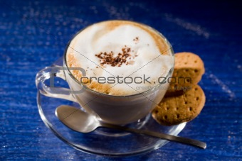Cappuccino on blue glass table