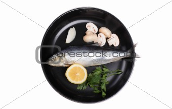 fish in pan with vegetables