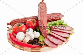 sliced sausage with vegetables and red papper