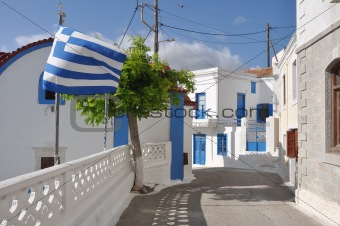greek village with greek flag