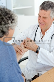 A senior doctor doing an examination of his patient