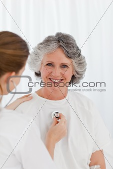 Nurse taking the heartbeat of her patient