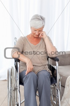 Thoughtful senior in her wheelchair