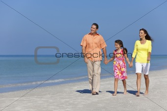 Happy Mother, Father and Daughter Family Walking on Beach
