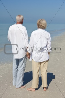 Happy Senior Couple Holdings Hands on A Tropical Beach