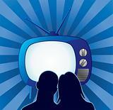 couple watching retro tv set