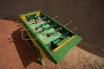 Green Foosball in the street