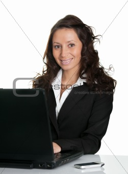 Beautiful business woman working on laptop