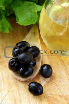 black olives and a bottle of olive oil