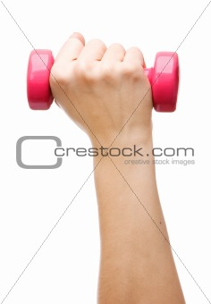 Female hand holding a dumbbell