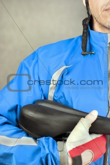 Cyclist Holds Bike Seat