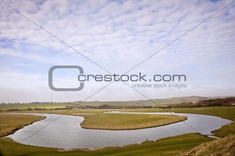 Beautiful landscape of river twisting through countryside
