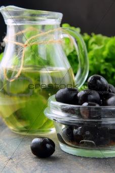 black olives and a bottle of olive oil