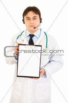 Authoritative medical doctor with headset holding blank clipboard