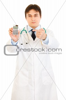 Authoritative medical doctor pointing finger on calculator