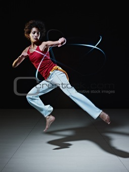 hispanic woman playing capoeira martial art