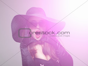 Young woman in black hat and sunglasses