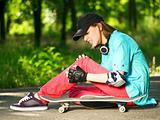 Teenage girl with skateboard