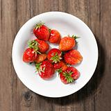 ripe strawberries on the plate