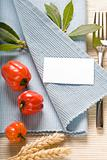 fork and vegetabels on blue napkin