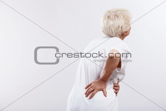 An elderly woman with back ache