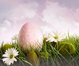 Large pink easter with flowers in tall grass
