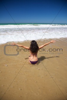 sensual woman in water at Conil beach