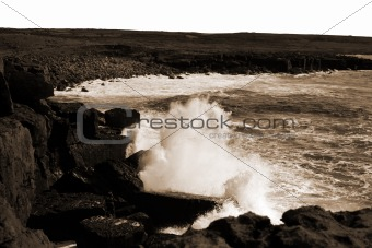 giant waves crashing on coast cliffs
