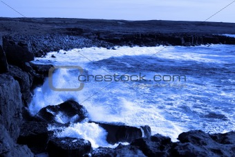 wave crashing on burren cliffs