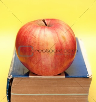 old book with apple on it