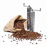 Coffee beans sack with scattered beans and metal coffee-grinders