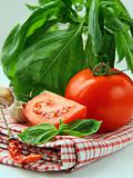 Fresh ripe tomatoes with basil and olive oil