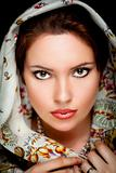 Portrait of beautiful girl  with old russian shawl on head. Retouched