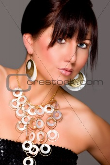 Charming young lady with beautiful jewelry. Retouched