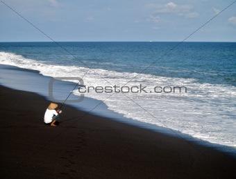 Fisherman on a beach